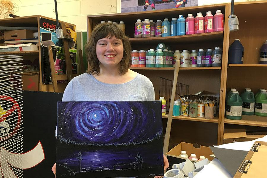 Art Assist- Junior Mary Brunn shows of one of her many art projects. Landscapes are Brunn's favorite thing to portray.