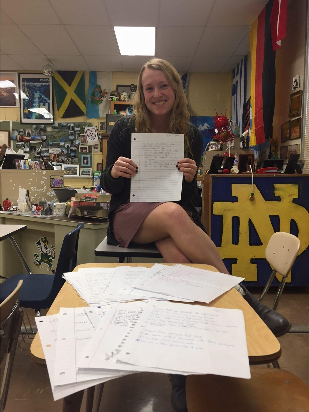 Senior Eden Slimmer holds up her ten resolutions. After winter break, AP Psychology students were required to write down and share ten of their goals with the class. Sharing your goals is proven to be more beneficial in accomplishing them.