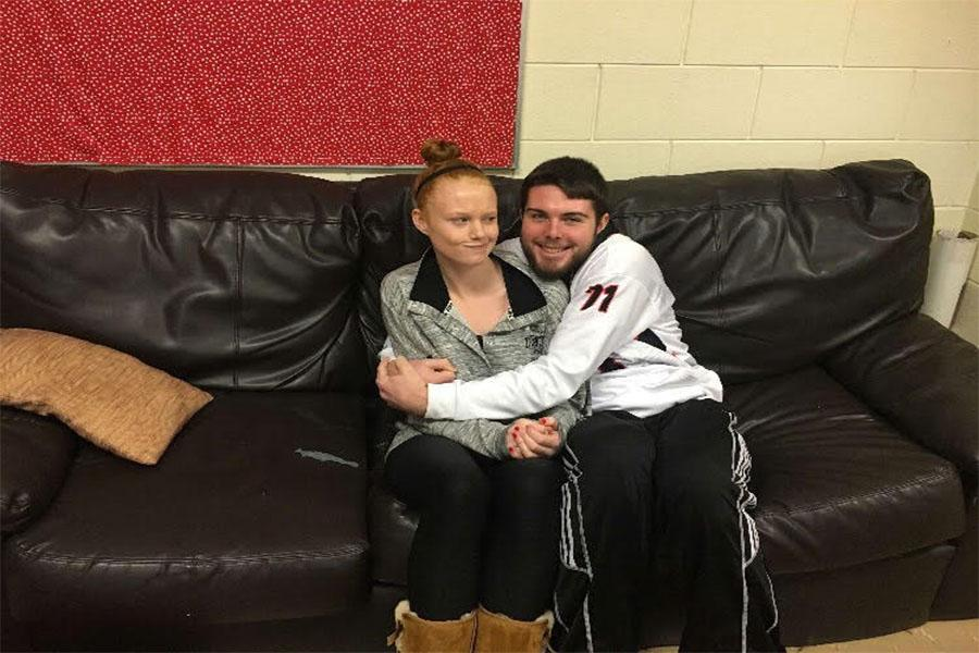 BROTHERLY LOVE-Senior Evan Horen and Freshman Lindsey Horen snuggle on the couch. While they can embarrass each other every once in awhile, they really do appreciate having the other at school.
