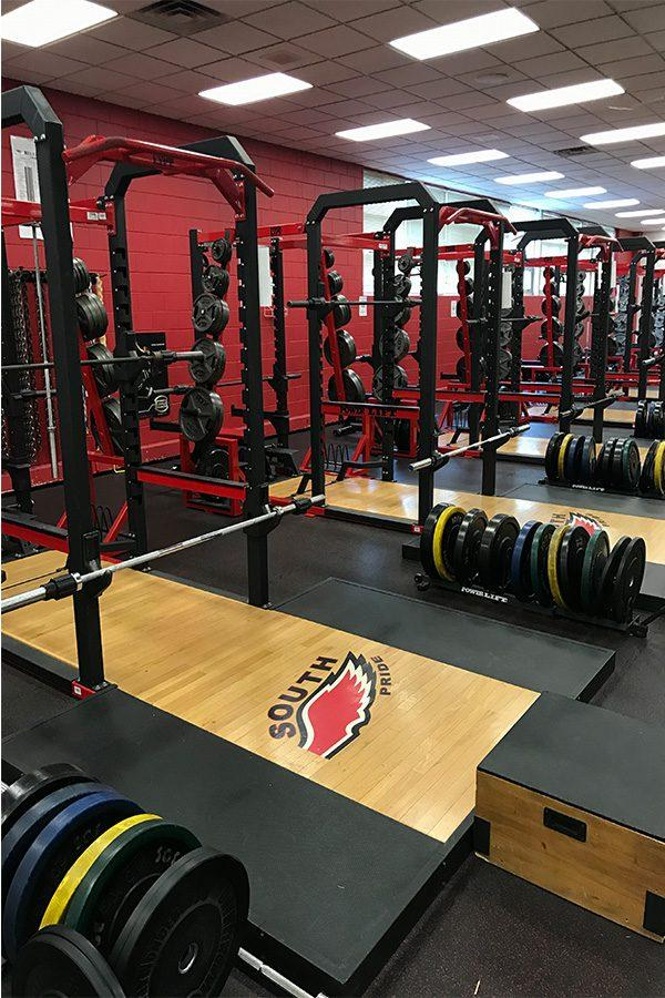 %E2%80%9CNO+DAYS+OFF-+During+summer+and+after+school%2C+the+South+High+fitness+center+is+filled+with+students+who+want+to+improve+their+fitness.+The+racks+are+typically+used+for+squats%2C+cleans+and+bench+press.