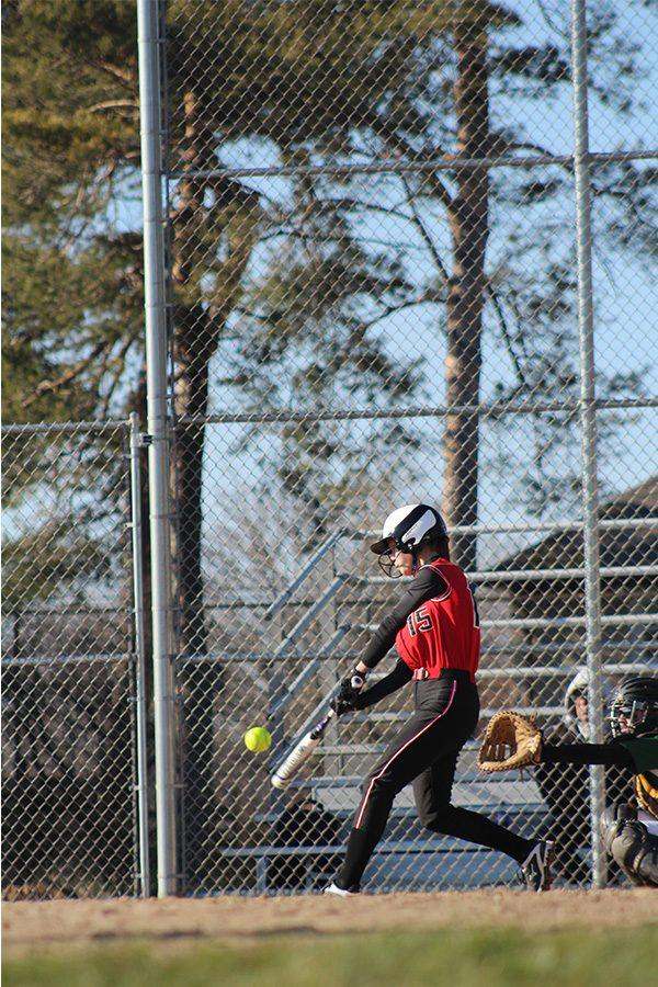 SWINGING+INTO+THE+NEW+SEASON-+Junior+Lindsey+Anderson+swings+at+an+incoming+pitch.+She+is+expected+to+be+a+key+member+of+the+softball+team+this+year.