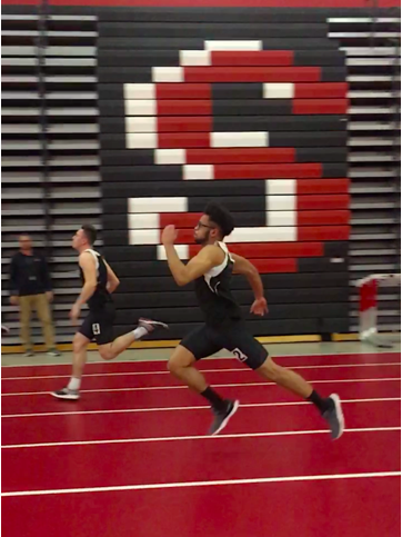 Sophomore Jacksen Wolff and Senior Jacob Case both participate in track and field. They are pictured running the 55 meter dash.