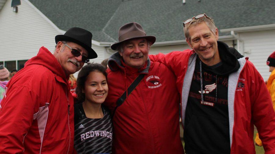 Hannah Braatz celebrates her amazing accomplishments with coaches Mike Littlefield, Gary Wondergem, and Brian Henriksen.