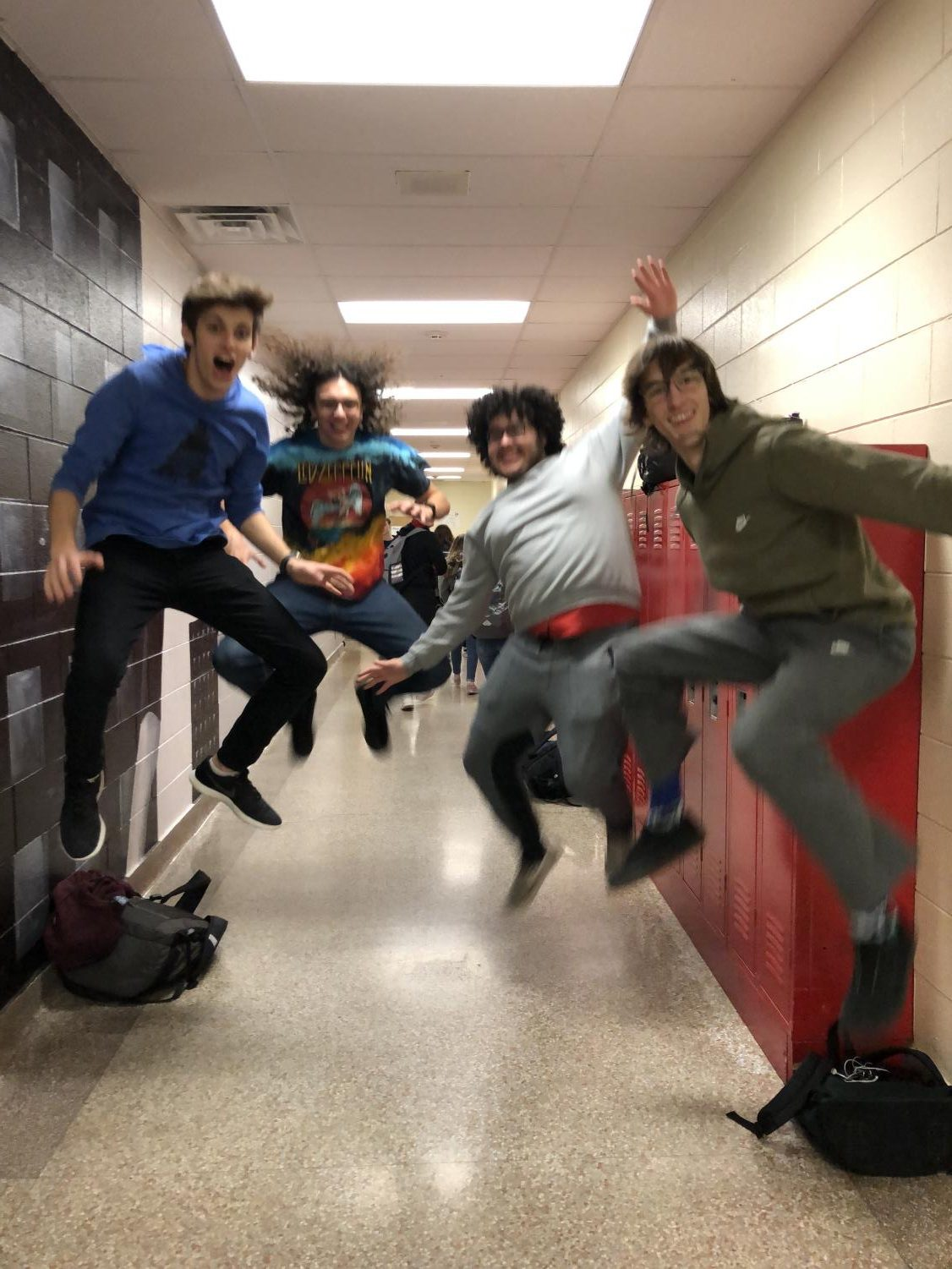 Junior Ian Zempel, Freshman Slater Gutierrez, Junior Johnny Montanez, and Senior Sam Kaffine jumping for joy for their musical accomplishments (or love of music).