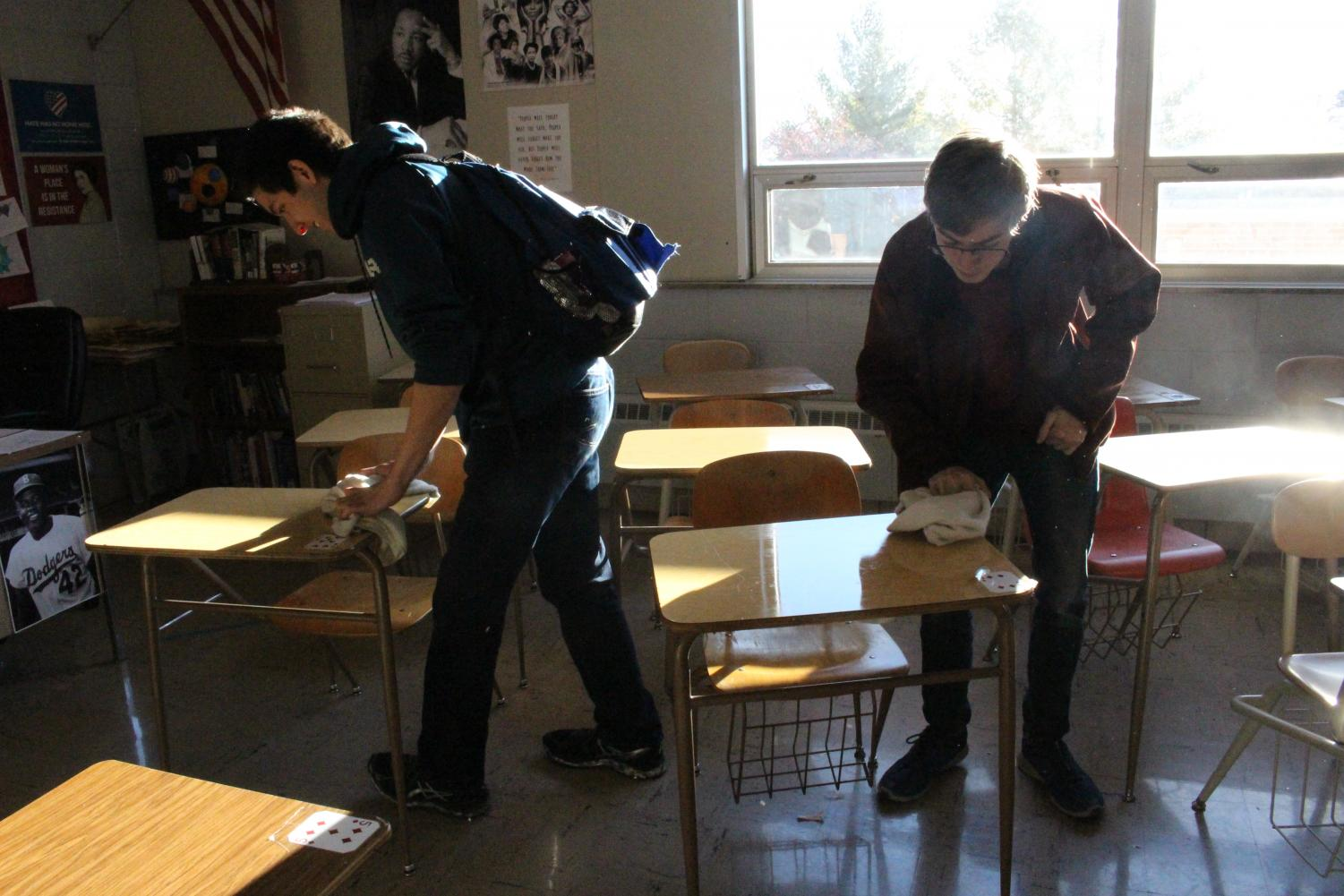 Many+students+chose+to+help+make+their+classrooms+cleaner+by+wiping+off+desks.