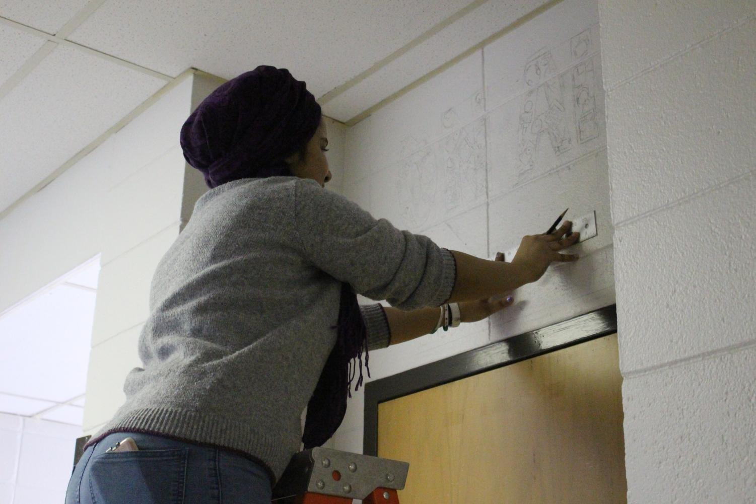 Senior%2C+Madiha+Maqsood%2C+spent+her+service+time+working+on+a+mural+above+the+broadcasting+studio.