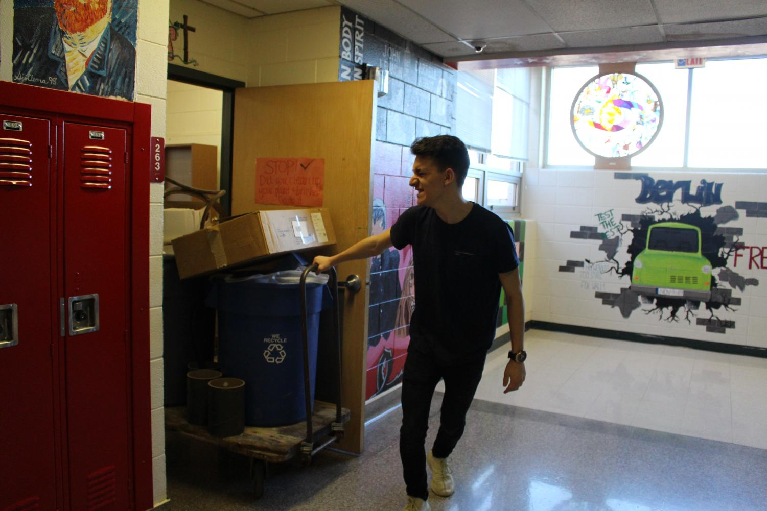 Senior%2C+Dorian+Laraku+helps+pull+the+trash+out+of+the+newly+cleaned+student+council+work+room.