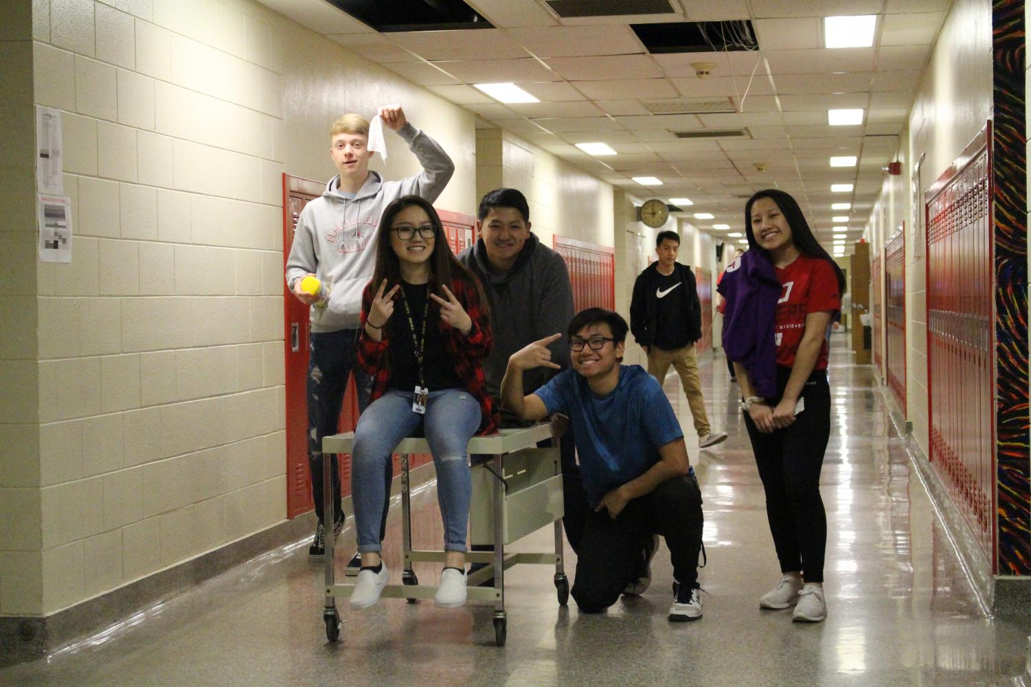A+group+of+students+stop+in+the+hallway+for+a+picture.+Luckily+none+of+the+damaged+ceiling+tiles+leaked+onto+them.