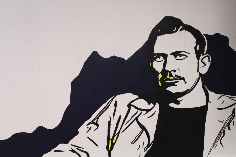 This mural of John Steinbeck is being painted by Junior Justine Soliz in English teacher Mr. Matthews classroom. Soliz chose to paint an author for the English classroom, but gave the normal picture a twist by adding geometric and colorful aspects.