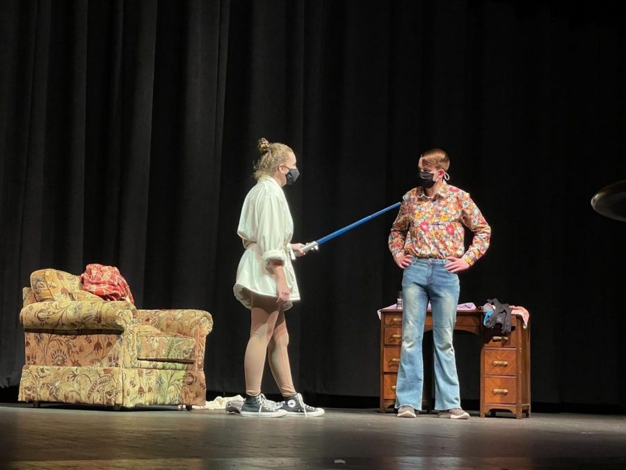 1. Ainsley Schwalbe's ('22) and Mason McWherter's ('22) fight over who's driving who to see the new Star Wars movie gets serious once lightsabers are involved in the 1977 vignette, A New Hopeless. 2. Daniel Ellair ('21) and Elizabeth Murphy ('22) try to help Ellair's character score the girl of his dreams… but not in the way Ellair expects, in the 1950s vignette, Lassoing an Angel.